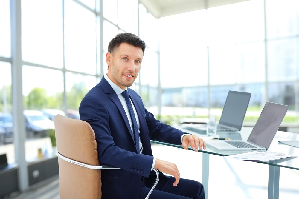 Professional man at meeting room desk